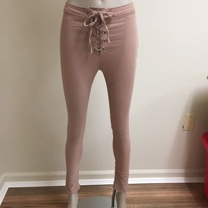 Super skinny pink lace up jeans